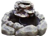 This is a two tiered faux river rock fountain. We