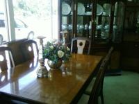 We have an elegant two-tone dining room set in