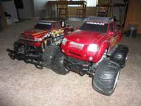 Selling these to toy trucks both are missing batterys