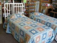 Item: Two twin beds with headboards and bedding, both
