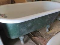 Two Claw foot tubs offered coming out of a 1906