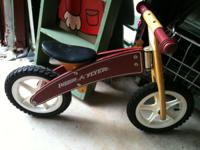 This is a wood radio flyer with two wheels. PRICE