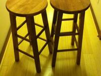I have two identical, maple-stained bar stools in great