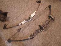 two compound bows both bears....(1) bear black bear in