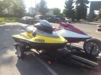 For sale 2 jet ski's and trailer. Red one a 99 polaris