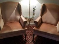 Two light pink plush fuzzy arm chairs/accent chairs.