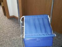 Two NEVER USED vintage aluminum fishing chairs with a