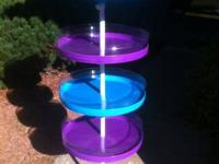 4 tier plastic and metal adjustable tower.  Each tier