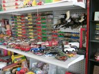 We have cast cars, old tin toys, Dolls, games of all