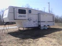 2000 golden falcon camper 32 ft 5th wheel camper loaded
