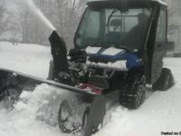 2008 Polaris Ranger with snowtracks and 4 tires with