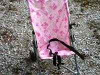 2 pink umbrella strollers and 1 green on for sale. The