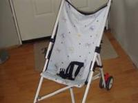 Umbrella Stroller neutral color only $5... call . Put