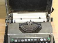 Underwood Portable Typewriter in case. $20 cash.