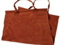 Our log carrier is made from brown suede leather and is