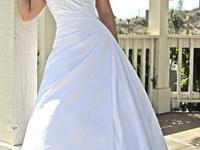 This gown has a sweetheart strapless bodice features an