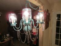 This beautiful verdi gris finish six light chandelier