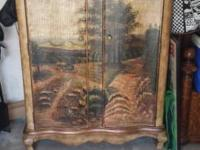 Unique armoire with painting of landscape on front. Has