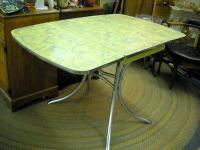 This is a very cool drop leaf table. Definitely a one
