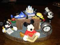 This is a Micky Mouse Desk Clock in NEW condition. It