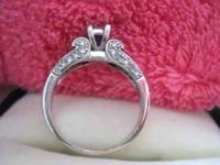 WHITE GOLD .25CT DIAMOND ENGAGEMENT/PROMISE RING.