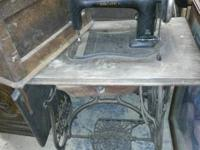 Says Domestic on the base and treadle and has a fold