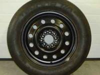 "This is a Universal 15 "" x 7 "" wide steel wheel with a"