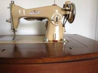 Stunning Antique Sewing Machine in Cabinet. This