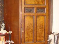 We have this impressive ANTIQUE edge armoire that