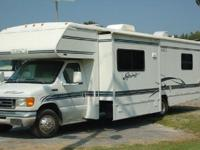 his Class C motorhome is 32 long and has 27,957 miles.