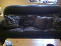 "Wonderful ""Up North"" design couch. Size: 86"" long x 42"""