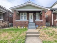 Updated brick home with a two car garage! Location: St