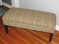 Opens for storage. Leopard skin print. Good condition.