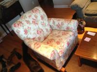 This is a relatively big upholstered rocking chair. It