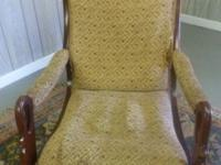 Beautiful antique rocking chair with upholstered seat,