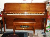 Beautiful wood Cable Player Piano with storage bench