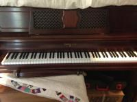 Sohmer & Co upright piano. Cherry wood finish. Front