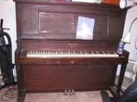 I'm selling an upright grand piano. It's dark brown. It