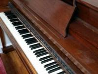 A World War II period piano. Kimball brand, made in