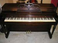 Upright piano built in U.S.A. by the Anderson Co.