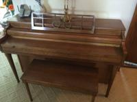 Upright piano with matching bench by the Gulbransen
