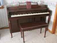 Upright piano, has been played regularly, $300. Please