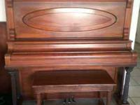 This is a Cable-Nelson Upright piano in excellent