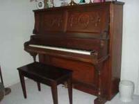 Upright piano .. looks good .. great tone .. has bench