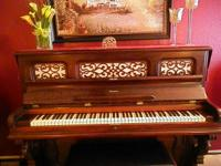 This beautiful Emerson upright piano is a piece of art,