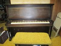 Nice small upright piano by Vose and Sons, manufactured