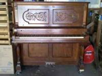 "This ""Adam Schaaf Cabinet Grand"" upright piano is free"