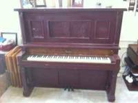 Antique upright piano. Lots of character! $500. Contact