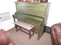 upright piano, in great working condion. make an
