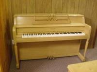 This is a beautiful blond piano with bench in great